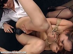 Watch a sexy Japanese brunette slave getting her pussy stuffed with a magic wand by a wild mistress. Then it's time for the femsub to gag herself on a thick rod of meat.
