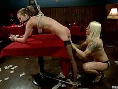 This female domination video has a blonde dominatrix playing with Lorelei Lee, tying her up, fucking her pussy with her strapon and more.