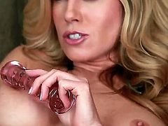 Young pretty blonde beauty Randy Moore with tight ass and natural boobies teases in close up and enjoys stuffing pink pussy glass dildo in provocative solo action filmed in close up.