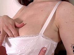 Karina Heart is a beautiful curvaceous brunette with massive natural tits. She strips out of her uniform and then pulls off her white bra. She loves touching her gigantic natural boobs.