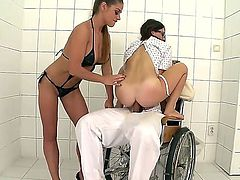 Cathy Heaven and Tiffany Doll were made to fuck this crazy guy while he sits in his wheel chair