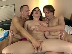 Watch this slutty brunette having fun with two big cocks in this hot video where she deep throats both of them until her mouth's filled by cum.