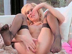 Adorable young blonde Hayden Hawkens with natural boobs and slim body in stockings only spreads legs and polishes her shaved tight honey pot while getting filmed in close up.