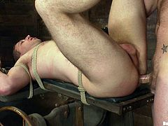 A couple of gay dudes have some pretty hot man on man sex in this super kinky bondage scene right here, hit play and check it out!