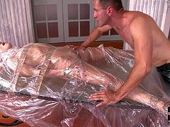 Leyla Black is a helpless wrapped up cutie that gets her pink tight pussy fisted with no mercy by kinky guy before he puts his hard throbbing cock in her mouth. Watch her get sexually humiliated.