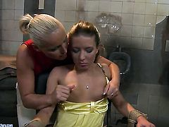 Blonde Bianca Arden plays with Kathia Nobilis breasts before she stimulates her twat