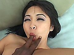 Asian slut Mika Tan tries her best to take lee bangs fat black cock in all three of her holes, and then swallows his cum.