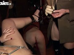 Blond mature woman is wearing mask playing kinky BDSM games. She gets handcuffed and chained. Her mistress pins her beaf curtains causing her pain.