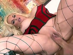 Skillful blonde bombshell Diamond Foxxx with huge fake tits and round bouncing ass in corset and fishnet pantyhose rides on stiff cannon in close up like there is no tomorrow.