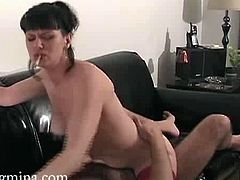 See the vicious brunette milf Mina riding her man's dong while having a smoke in this sexy amateur video. She looks very hot in those red stockings doesn't she?