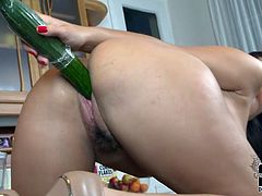 Slutty babe likes to masturbate hard and stuff her shaved pussy with large things