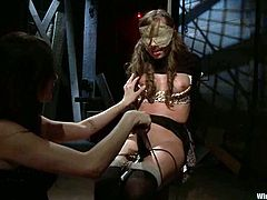 Sweet brown-haired babe gets tied up by her mistress. After that she also gets toyed with a vibrator and a fucking machine.