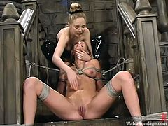 Cute fair-haired girl Audrey Leigh is playing BDSM games with her lesbian GF in a basement. The mistress fucks Audrey's cooch with a toy and then drowns the girl in a bathtub.