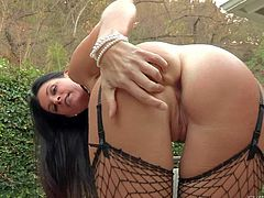 Tall brunette India Summer is a charming milf with perfect body. Long haired slim woman strips down to her lingerie. She displays her bush and her round bare ass outdoors with no shame.