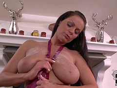 Sheila Grant plays with her huge baps in the kitchen