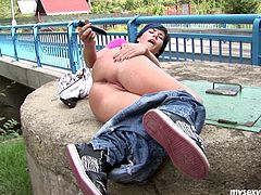 Nikita is kinky chick who loves going kinky outdoor in public places. She flashes her boobs and then shaved pussy too. She rubs her cherry actively. Later she lies on a huge stone keeping her legs together. Nikita inserts big dildo in her tight asshole stretching the hole wide.