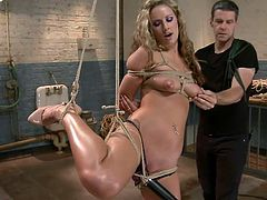 Tied and treated like a cheap whore blonde baby Dallas is enjoying her punishment. The executor squeezed her tits with rope, rubbed her pussy with that vibrator and now left her in that uncomfortable position. Will he return to finish the job? Stay tuned to find out