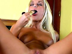 Sexy blonde Lola in solo action playing with a huge dildo as it penetrates her tight cunt