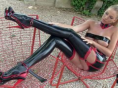 Danielle Maye is a latex clad sexy blonde. She shows off her perfect long legs and flashes her pussy in the backyard. Shes damn sexy in black latex stockings and high heels.