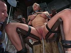 Busty blonde chick gets tied up to a bondage chair. After that the guy shoves a hose into her pussy and pumps it with water. After that she also gets toyed with a vibrator.