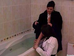 So there're two kinky MILFs about to take bath fully clothed. Brunette mommy gets her tight ass spanked by her girlfriend. Check out those bitch's sexy legs.