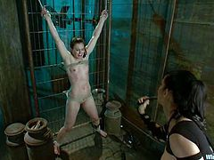 Cheyenne Jewel allows bosomy brunette milf Isis Love tie her up and torment her in a basement. Isis attaches a wire to the dildo sticking out of Viki's cunt and watches the cutie get an orgasm.