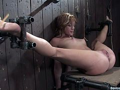 A skinny bitch gets her nipples yanked and toyed with and her pussy fucked by a fucking device in this bondage scene right here!