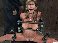 It's one wild bondage video with some torture to see too, as the blonde stunner with very nice tits gets totally immobilized by some weird bondage and toy fucks her pussy.