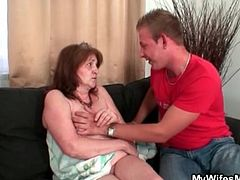 Sucking big tits of his mother in law