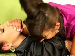 Two hot blooded brunette lesbians make out on the bright citron couch. They tear off each other's clothes with passion before one of them starts poking soaking cunt of another slut with dildo.