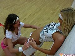 Two  sporty teens are kissing hot and toying each others  vags on the court