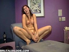 Naughty redhead Ruby has a wet pussy and the only thing that makes her feel better is when she fucks her big brutal dildo, stretching her twat to its limits in this free sex clip.