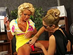 Sex hungry tasty looking MILFs make out in office. Raunchy blonde sits on the desk with tight spread wide while another slut hammers her vagina with pink dildo.