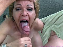 Lewd blonde mom Kelly Leigh gets on her knees in front of some guy and begins to suck his schlong. She rubs it passionately as well and soon gets loads of cum on her tongue.
