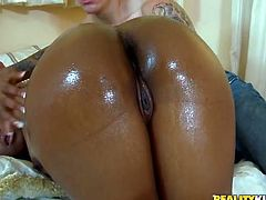 Dark skinned bitch with ample booty is oiled up all over. She demonstrates her gorgeous booty on cam showing in close-up shot. Then she polishes solid white stick like vacuum cleaner.