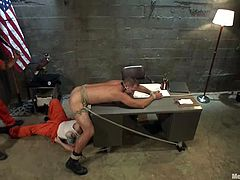 It so happened that officer Andrew Justice got lured in the cell and attacked. He couldn't fight back the convicts and now they are torturing him in BDSM!