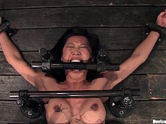 A hot bondage scene with an arousing fucking Asian slut gettin' tied up and toyed with, hit play and check it out right here!
