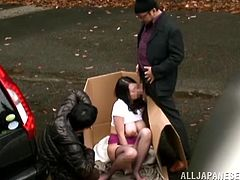 Nachi Kurosawa and two creepy men have sex in the middle of the street. They find a vacant parking lot and take out a cardboard box to hide their activities. She gets fingered and then is fuck against the rail around a garden.
