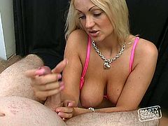 Blond stunner is incredibly seductive and beautiful woman having gorgeous boobs. She is sitting down on her knees stocking dick intensively performing hot professional handjob.