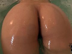 Attractive blond girl strips in the bathroom tracing her hands over her body. Then she bathes in a spa fondling her pussy. Later she soaps her privates showing it close-up. She also direct a water stream to her pussy getting pleased.