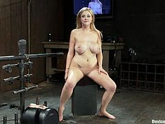 Katie Kox is having her big tits squeezed by the bondage device while she's forced to ride a sybian in this BDSM porn video!