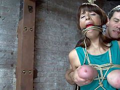 Sweet Nina has been tied up like a whore and her mouth was ball gagged and tied also. Nina is about to be treated the way we like to here at Hogtied, she doesn't receives respect or mercy as the executor gropes her squeezed boobs and rubs her pussy with a vibrator. Yeah, she deserves this treatment and much more