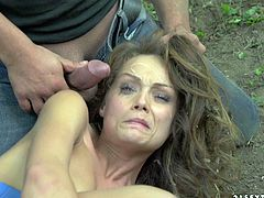 Her friend drives deep in the woods and then ties her up on the tree. This guy finds her and instead of helping her he rapes her wet pussy in bondage!