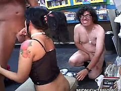 Ample brunette hooker with her body covered with black lingerie and fishnet stockings serves bunch of sex hungry greasy men right in the grocery store. She gives them blowjob and polishes their anuses in peppering gangbang sex video by Pornstar.
