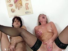 Naughty grannies Oliva and Terezie finger fuck each other being oiled up all over. They rub oil over they bodies watching each other masturbating. Messy wicked porn clip presented by Mom Loves Mom.