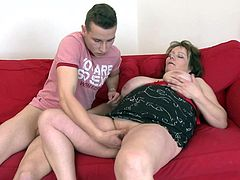 She stays with her thighs spread wide and receives a deep pussy fingering from this much younger guy. His fingers in her vagina makes the bbw hornier and she can't stand it any longer. The whore greedily grabs his cock and sucks it before getting her cunt filled with that penis. Yeah, she likes that a lot!