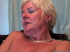 Watch the vicious and provocative blonde mature Sandy taking her clothes off and dildoing her pussy into a breathtaking orgasm.