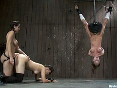 There's lesbian strapon action, crazy bondage with one girl hanging upside down from the ceiling with a sybian fucking her pussy and more domination and torture going on.