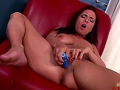 Pretty dark haired bombshell Ashley Graham with arousing make up and long red nails spreads sexy legs and polishes pink hone pot with blue vibrator to orgasm in close up.