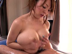 This smoking hot Japanese masseur is going to amaze her client. She oils him up and gives her cunt to him for a nice poking session!